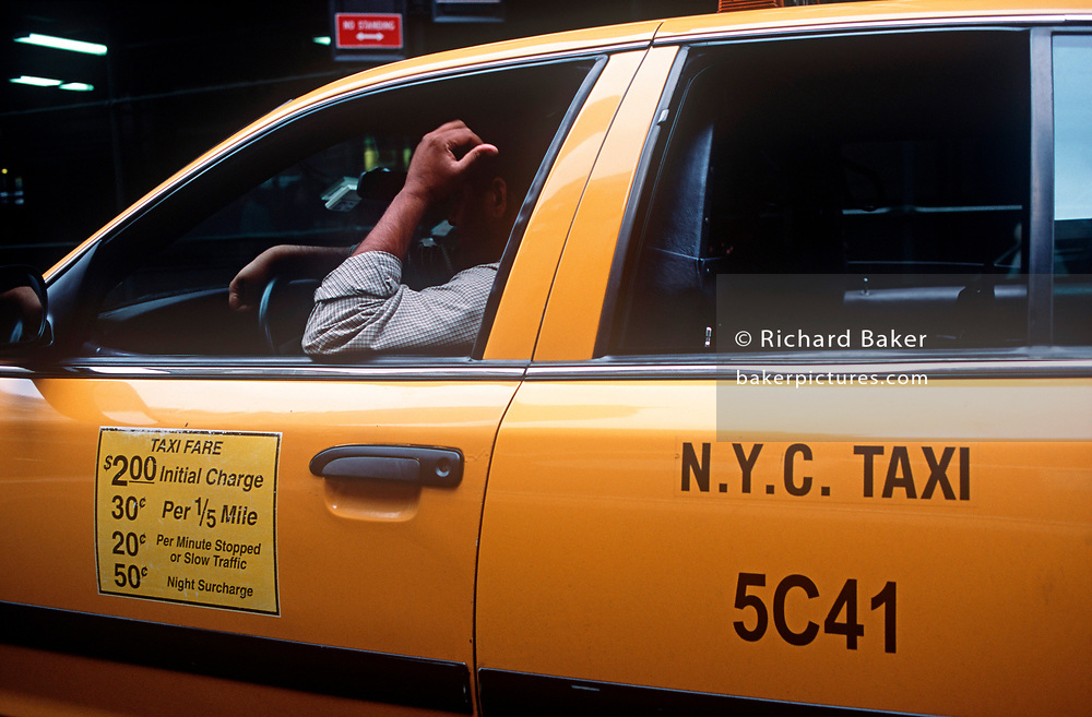 Fare prices and the arm of a New York City cab driver in Manhattan, on 21st September 2001, in New York, USA. (Photo by Richard Baker / In Pictures via Getty Images)