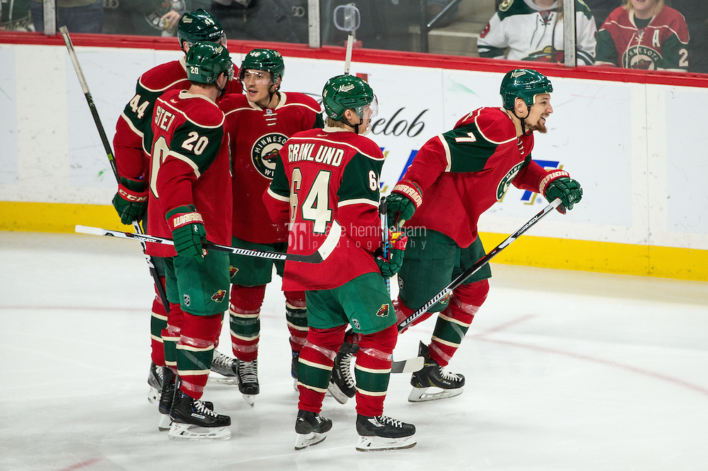 Dec 17, 2016; Saint Paul, MN, USA; Minnesota Wild forward Chris Stewart (7) celebrates his goal with teammates during the third period against the Arizona Coyotes at Xcel Energy Center. The Wild defeated the Coyotes 4-1. Mandatory Credit: Brace Hemmelgarn-USA TODAY Sports