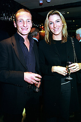 Jockey RICHARD DUNWOODY and MISS CHARLOTTE HUTCHINGS, at a party in London on 4th October 2000.OHP 76