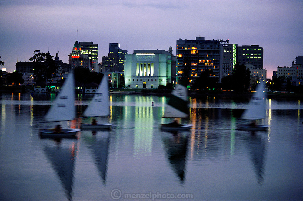 Sailboats on a summer evening on Lake Merritt in downtown Oakland, California.