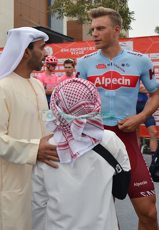March 1, 2019 - Ajman, United Arab Emirates - Sheikh Ahmed bin Humaid Al Nuaimi, Chairman of the Economic Department of Ajman Emirate chats with German rider, Marcel Kittel, of Katusha-Alpecin Team, at the start line of the sixth Rak Properties Stage of UAE Tour 2019, a 180km with a start from Ajman and finish in Jebel Jais. .On Friday, March 1, 2019, in Ajman, Ajman Emirate, United Arab Emirates. (Credit Image: © Artur Widak/NurPhoto via ZUMA Press)