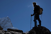 A trekker approaching Mt Everest base camp on the Khumbu glacier. Image by Greg Beadle