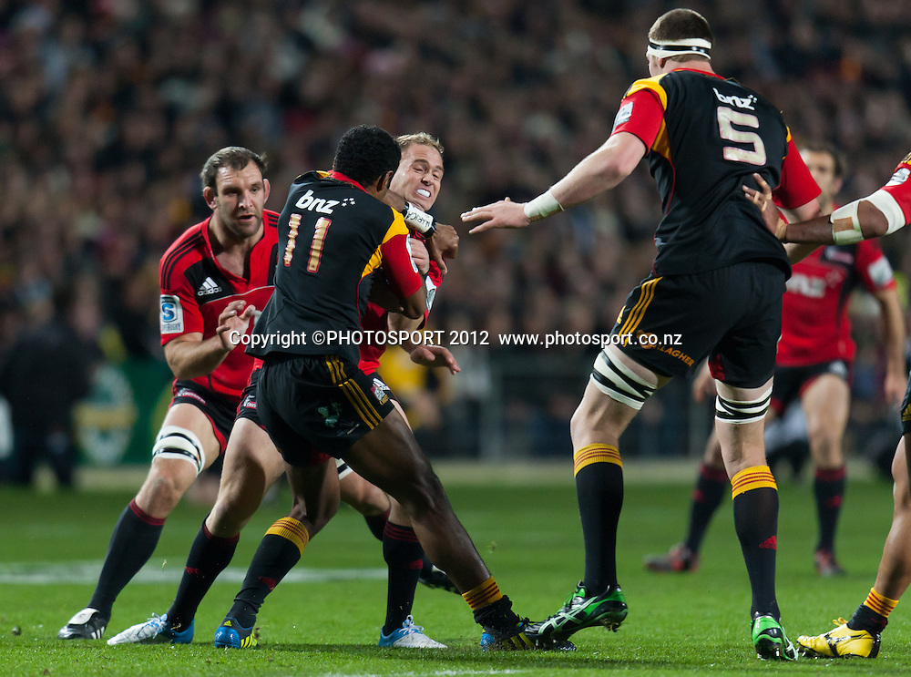 Crusaders' Andy Ellis is tackled by Chiefs' Asaeli Tikoirotuma during the Super Rugby Semi Final won by the Chiefs (20-17) against the Crusaders at Waikato Stadium, Hamilton, New Zealand, Friday 27 July 2012. Photo: Stephen Barker/Photosport.co.nz