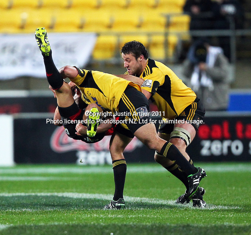 Aaron Cruden spear tackles Dan Cater.Super15 rugby union match - Crusaders v Hurricanes at Westpac Stadium, Wellington, New Zealand on Saturday, 18 June 2011. Photo: Justin Arthur / photosport.co.nz