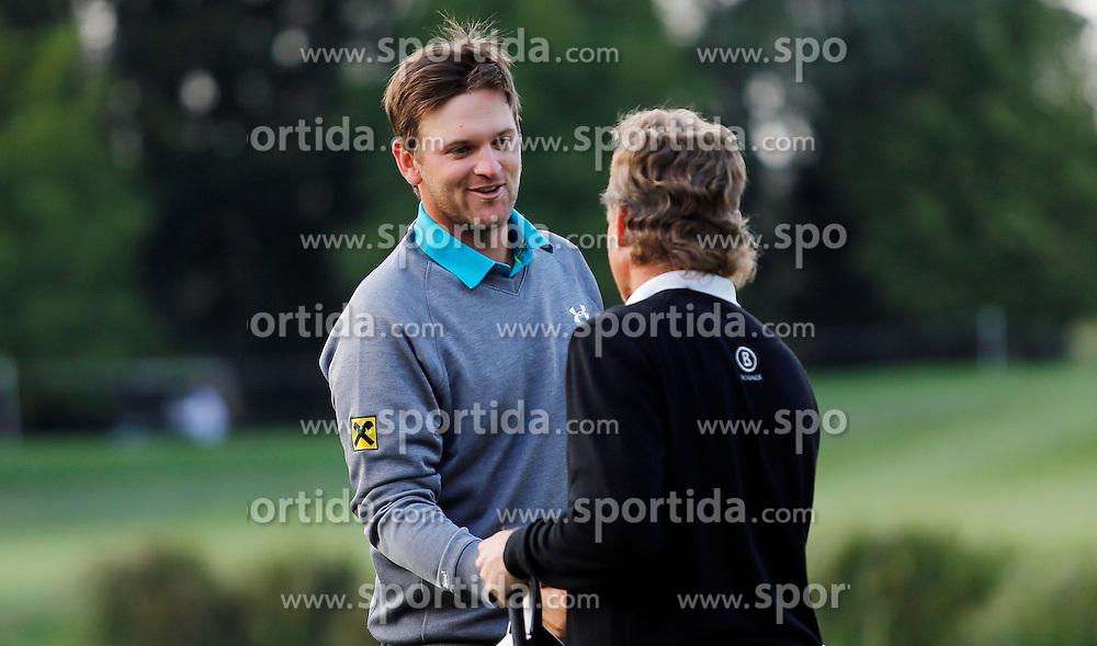 24.09.2015, Beckenbauer Golf Course, Bad Griesbach, GER, PGA European Tour, Porsche European Open, im Bild Bernd Wiesberger und Bernhard Langer am Schluss der Runde an der 18 // during the European Tour, Porsche European Open Golf Tournament at the Beckenbauer Golf Course in Bad Griesbach, Germany on 2015/09/24. EXPA Pictures &copy; 2015, PhotoCredit: EXPA/ SM<br /> <br /> *****ATTENTION - OUT of GER*****