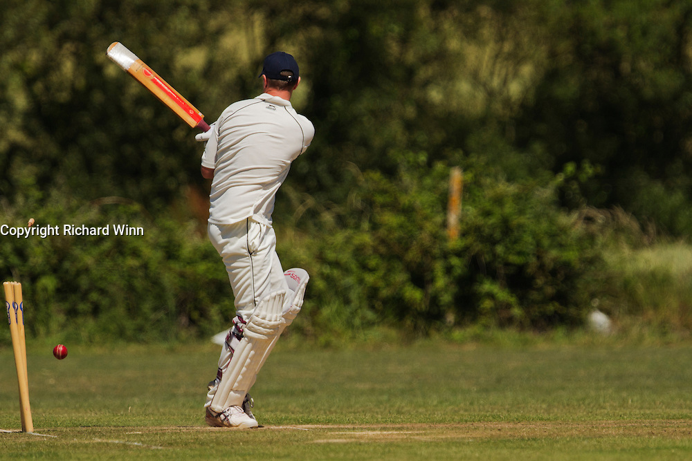 A batsman being bowled out in a cricket match at Kilve Cricket Club, between Kilve and Dunster.