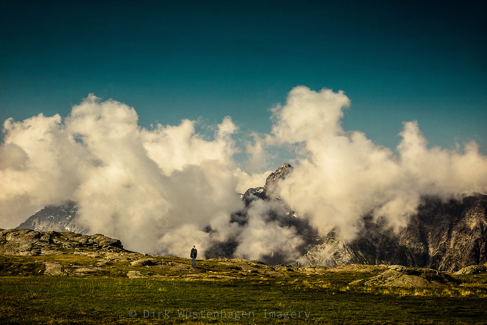 Man enjoying a panoramic view of the italian Alps near Chiareggio, Valmalenco, Tessino, Italy.<br />