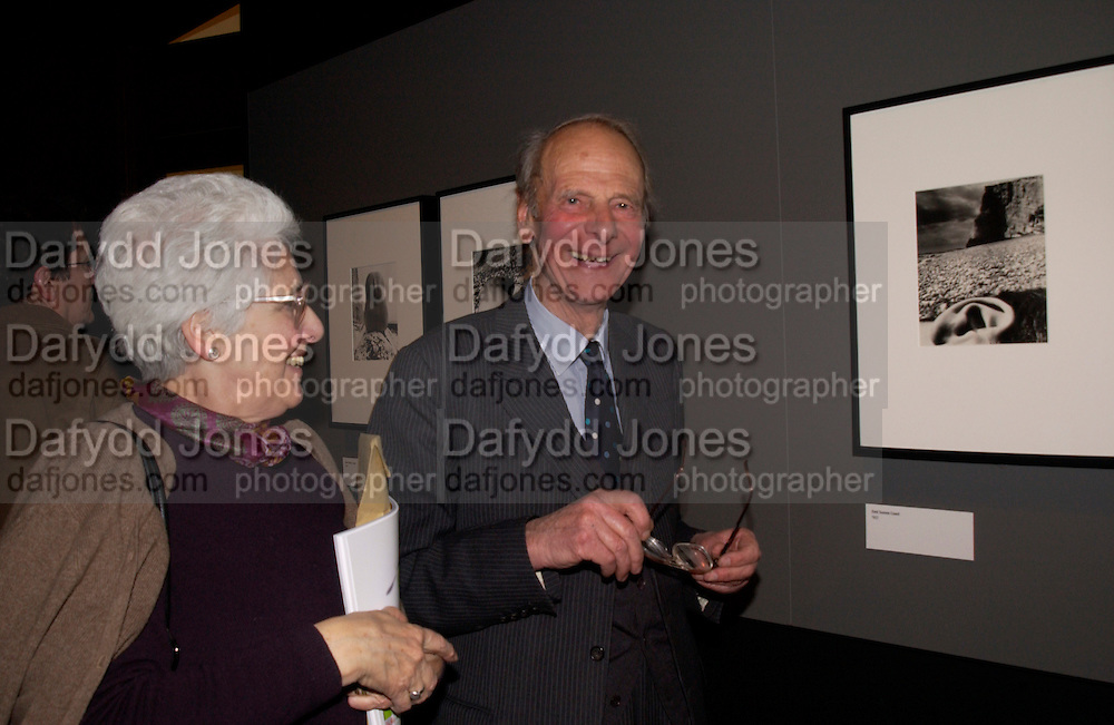 Peter Brandt and Ruth Pitman with the photograph of her ear,' East Sussex coast 1957' Bill Brandt exhibition exhibition opening, V. & A. 22 March 2004. ONE TIME USE ONLY - DO NOT ARCHIVE  © Copyright Photograph by Dafydd Jones 66 Stockwell Park Rd. London SW9 0DA Tel 020 7733 0108 www.dafjones.com
