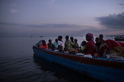 SEBAGORO, UGANDA - MARCH 23: A boat filled with Congolese refugees lands at Sebagoro, Uganda on March 23, 2018. Violence in Ituri Province in northeastern Democratic Republic of Congo has displaced more than 100,000 people including approximately 40,000 refugees who have fled to Uganda. (Photo by Andrew Renneisen for The Washington Post)