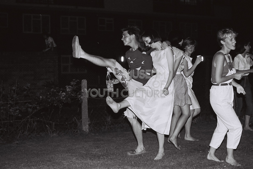 Teenagers dancing at garden party, West London, UK, 1983