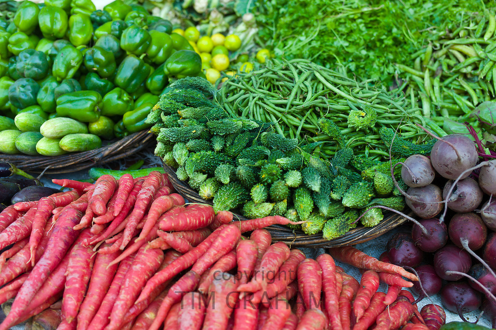 Fresh vegetables, carrots, green peppers, beetroot, beans, cucumbers, peas on sale at market stall in Varanasi, Benares, India