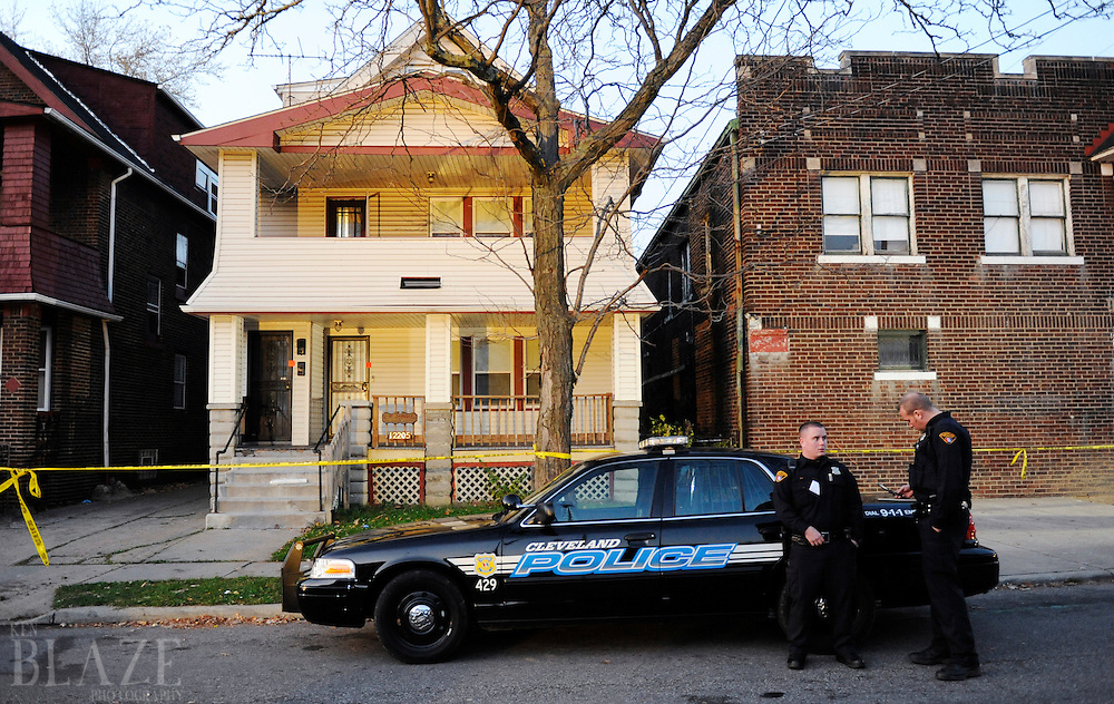 Cleveland police stand in front of the home of Anthony Sowell at 12205 Imperial Avenue in Cleveland on Wednesday November 4, 2009. Police have discovered as many as 11 bodies in the home...Ken Blaze for the New York Times.