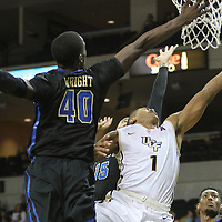 ORLANDO, FL - DECEMBER 31:  B.J. Taylor #1 of the UCF Knights drives to the net against D'Andre Wright #40 of the Tulsa Golden Hurricane during an NCAA basketball game at the CFE Arena on December 31, 2014 in Orlando, Florida. (Photo by Alex Menendez/Getty Images) *** Local Caption *** B.J. Taylor; D'Andre Wright