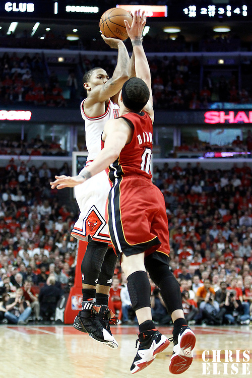 18 May 2011: Chicago Bulls point guard Derrick Rose (1) takes a jump shot over Miami Heat point guard Mike Bibby (0) during the Miami Heat 85-75 victory over the Chicago Bulls, during game 2 of the Eastern Conference finals at the United Center, Chicago, Illinois, USA.