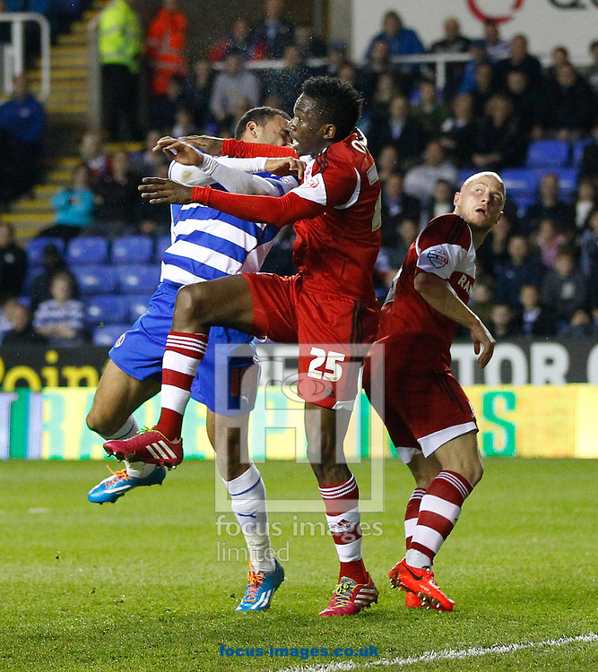 Kenneth Omeruo of Middlesborough (25) connects with Hal Robson-Kanu of Reading injuring his face and resulting in him being substituted after treatment during the Sky Bet Championship match at the Madejski Stadium, Reading<br /> Picture by Andrew Tobin/Focus Images Ltd +44 7710 761829<br /> 22/04/2014