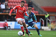 Wycombe Wanderers midfielder Dominic Gape (4) holds up Swindon Town striker Keshi Anderson (30) 1-0 during the EFL Sky Bet League 2 match between Swindon Town and Wycombe Wanderers at the County Ground, Swindon, England on 21 October 2017. Photo by Alan Franklin.