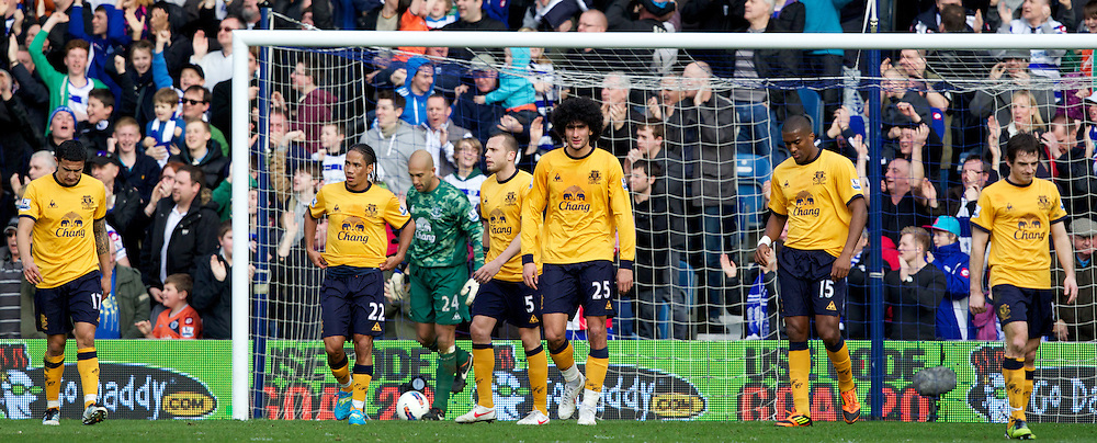 LONDON, ENGLAND - Saturday, March 3, 2012: Everton's Tim Cahill, Steven Pienaar, goalkeeper Tim Howard, John Heitinga, Marouane Fellaini, Sylvain Distin and Leighton Baines look dejected as Queens Park Rangers score the equalising 1-1 goal during the Premiership match at Loftus Road. (Pic by Vegard Grott/Propaganda)