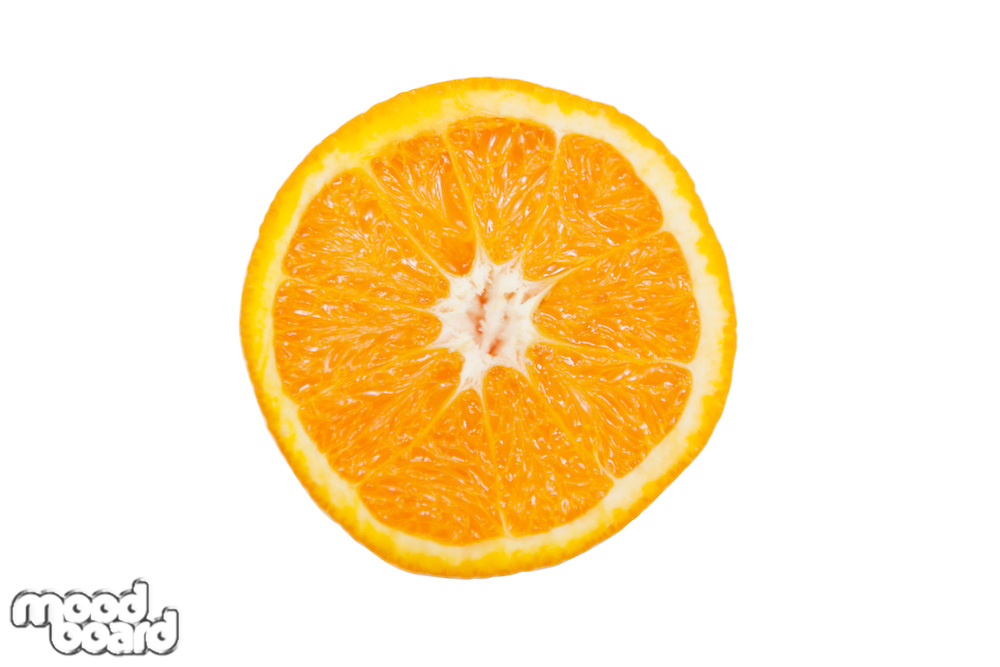 Cross section of sliced pulpy orange against white background