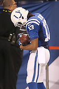 Indianapolis Colts wide receiver T.Y. Hilton cradles the football after his 73-yard touchdown catch in honor of his newborn daughter. Indianapolis hosted Jacksonville at Lucas Oil Stadium on Sunday, November 23, 2014.