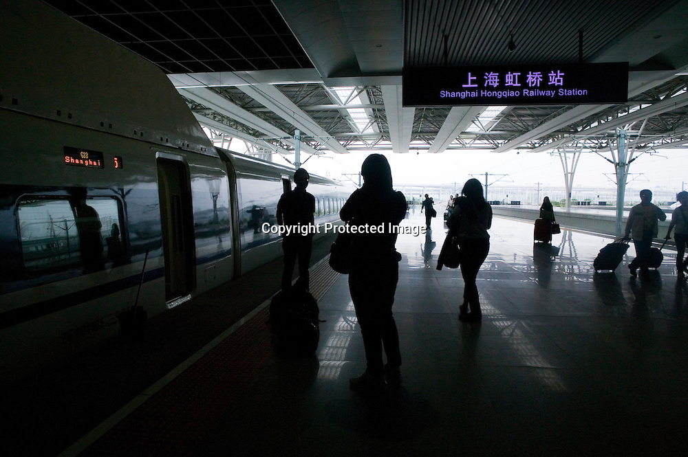 Beijing, September 11 , 2011 : arriva at Shanghai Hongqiao station. Passengers take souvenir photos of each other before they leave the platform.the passenger-dedicated trunk line opened in June 2011, reducing the 1,318 km journey between Beijing and Shanghai to less than 5 hours. Trains reach top speeds of 300 km/h (186 mph) for the entire trip.