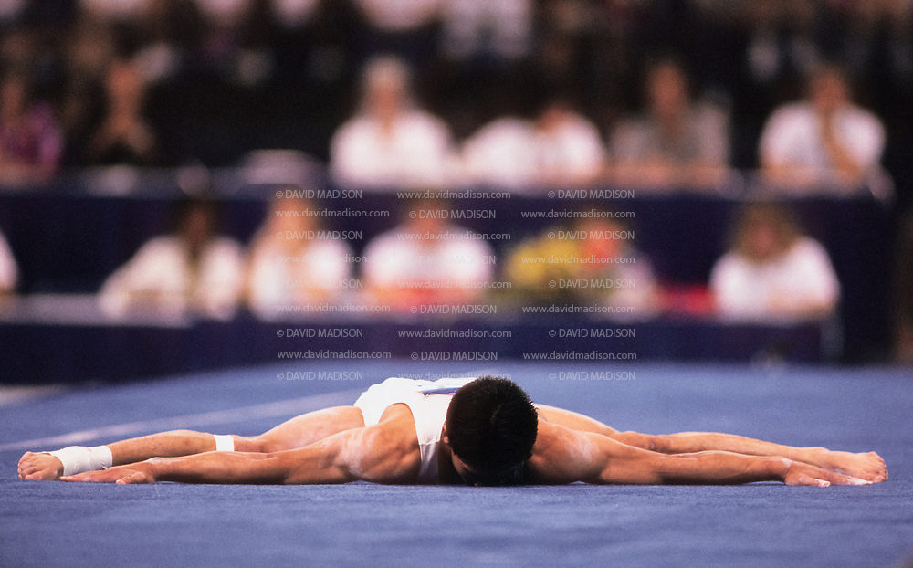 SEATTLE - JULY 1990:  Shinji Gamou of Japan performs in the floor exercise during the Men's Gymnastics competition of the 1990 Goodwill Games held from July 20 - August 5, 1990.  The gymnastics venue was the Tacoma Dome in Tacoma, Washington.  (Photo by David Madison/Getty Images)