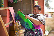 Asia Diwala sets out her Batik shop front to attract customers.<br /> <br /> Asia owns and runs a Batik business in KwaMatias, Tanzania.<br /> <br /> She attended MKUBWA enterprise training run by the Tanzania Gatsby Trust in partnership with The Cherie Blair Foundation for Women.