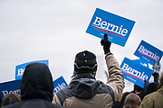 Supporters wave posters for Democratic 2020 presidential candidate Bernie Sanders during a rally at James Madison Park in Madison, WI on Friday, April 12, 2019.
