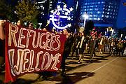 Frankfurt am Main | 21 Apr 2015<br /> <br /> Am Dienstag (21.04.2015) hielt die rassistische und islamfeindliche Gruppe PEGIDA (Patriotische Europ&auml;er gegen die Islamisierung des Abendlandes) an der Hauotwache neben der Katharinenkirche in Frankfurt am Main eine Mahnwache unter dem Motto &quot;Wir sind wieder da&quot; ab. Die Kundgebung war wie immer mit Hamburger Gittern abgesperrt und von starken Polizeikr&auml;ften bewacht. Etwa 1000 Menschen nahmen an den Gegenprotesten teil.<br /> Hier: Gegendemonstranten mit einem Transparent mit der Aufschrift &quot;Refugees Welcome&quot; bei einer Spontandemo nach Ende der Pegida-Kundgebung am Euro-Zeichen am Willy-Brandt-Platz, bei dieser Demo ging es um Flucht und Fl&uuml;chtlinge.<br /> <br /> &copy;peter-juelich.com<br /> <br /> [Foto Honorarpflichtig | No Model Release | No Property Release]