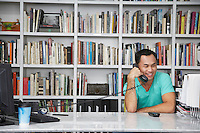 Man Phoning in Home Office