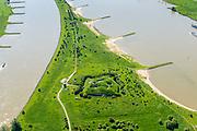 Nederland, Gelderland, Gemeente Lingewaard, 29=0502019; de Pannerdensche Kop. De Rijn splitst zich hier in Waal (rechts, richting Nijmegen) en Pannerdensch Kanaal (links, overgaand in Neder-Rijn richting Arnhem). Op de landtong Fort Pannerden, onderdeel van de Nieuwe Hollandse Waterlinie. <br /> The Rhine bifurcates into river Waal and Pannerdensch Channel (right, becoming Lower Rhine direction of Arnhem). The former Fort Pannerden is located about halfway between the headland.<br /> <br /> luchtfoto (toeslag op standard tarieven);<br /> aerial photo (additional fee required);<br /> copyright foto/photo Siebe Swart