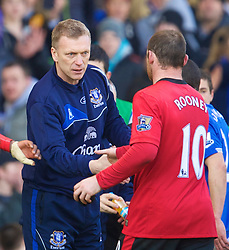 LIVERPOOL, ENGLAND - Saturday, February 20, 2010: Everton's manager David Moyes and Manchester United's Wayne Rooney shake hands after Everton's 3-1 win during the Premiership match at Goodison Park. (Photo by: David Rawcliffe/Propaganda)
