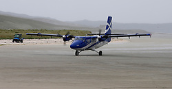 Barra Airport is a short-runway airport situated in the wide shallow bay of Traigh Mhòr at the north tip of the island of Barra in the Outer Hebrides, Scotland. Barra is now the only beach airport anywhere in the world to be for scheduled airline services. Loganair Twin Otter approaching terminal building. (c) Stephen Lawson | Edinburgh Elite media