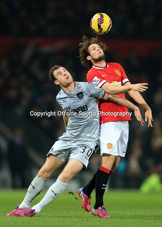 11th February 2015 - Barclays Premier League - Manchester United v Burnley - Ashley Barnes of Burnley  battles with Daley Blind of Man Utd - Photo: Simon Stacpoole / Offside.