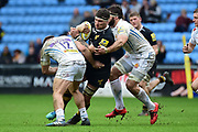 Wasps number 8 Guy Thompson  is tackled during the Aviva Premiership match between Wasps and Exeter Chiefs at the Ricoh Arena, Coventry, England on 18 February 2018. Picture by Dennis Goodwin.