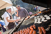 Charleston Chef Sean Brock, right, talks with Finnish chef Sasu Laukkonen during Cook it Raw outdoor BBQ event on Bowen's Island October 26, 2013 in Charleston, SC.
