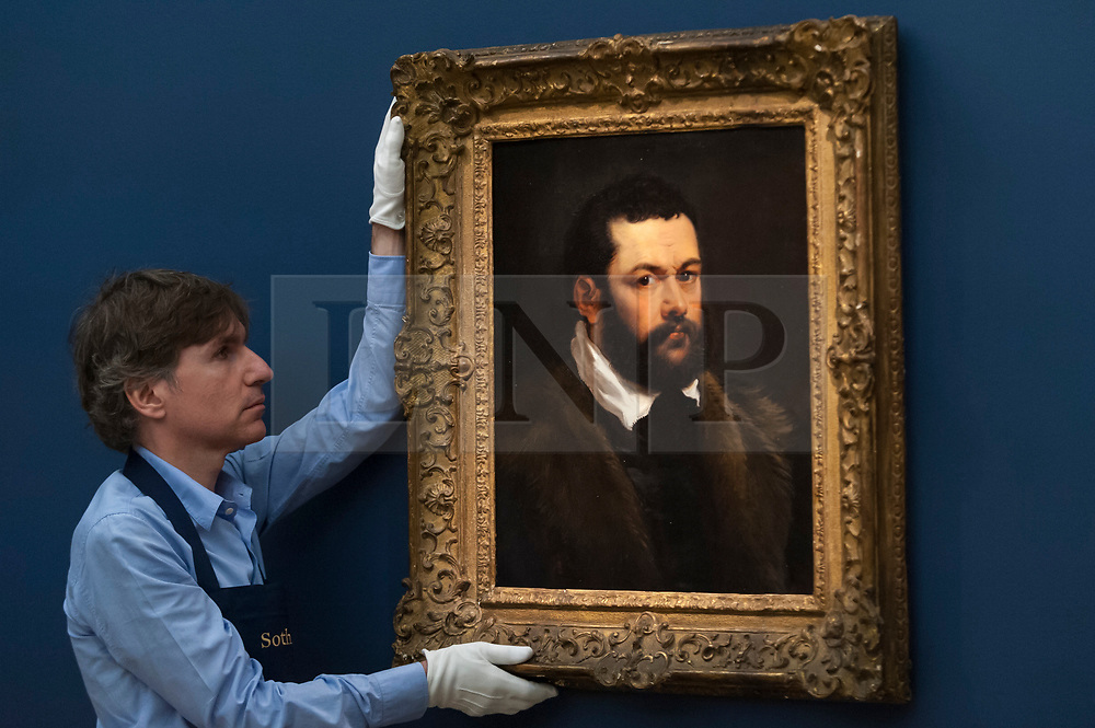 """© Licensed to London News Pictures. 29/06/2018. LONDON, UK. A staff member presents """"Portrait of a Venetian Nobleman"""" by Sir Peter Paul Reubens (Est. £3-4m).  Preview of Old Masters, British, Treasures, Sculptures and Ancient works at Sotheby's New Bond Street to be offered for sale on 3 and 4 July 2018.  Photo credit: Stephen Chung/LNP"""
