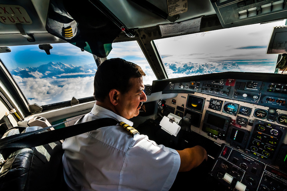 Pilot of Yeti Airlines Jetstream 41 on the Everest Express flight with 29,029 foot Mt. Everest in background (8848 m); Nepal.