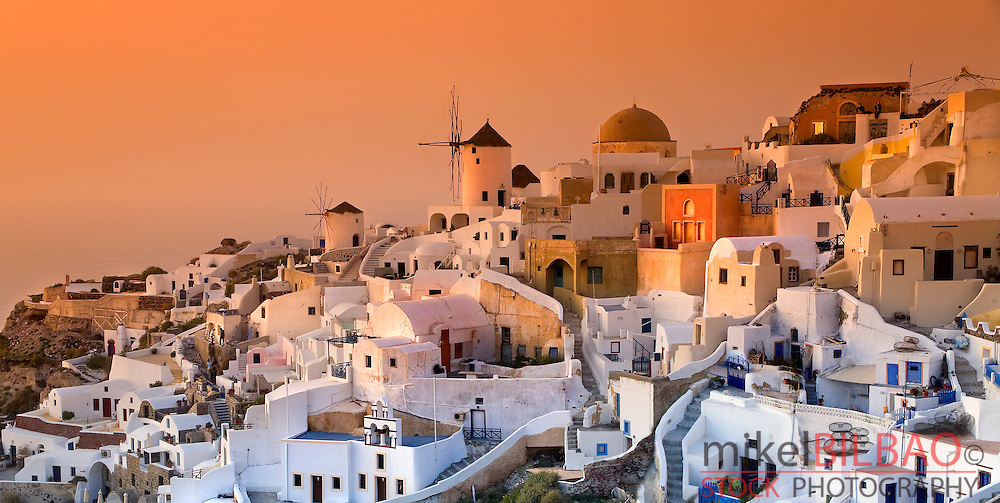 Oia village at sunset. <br /> Santorini island. Cyclades islands, Aegean Sea, Greece, Europe.