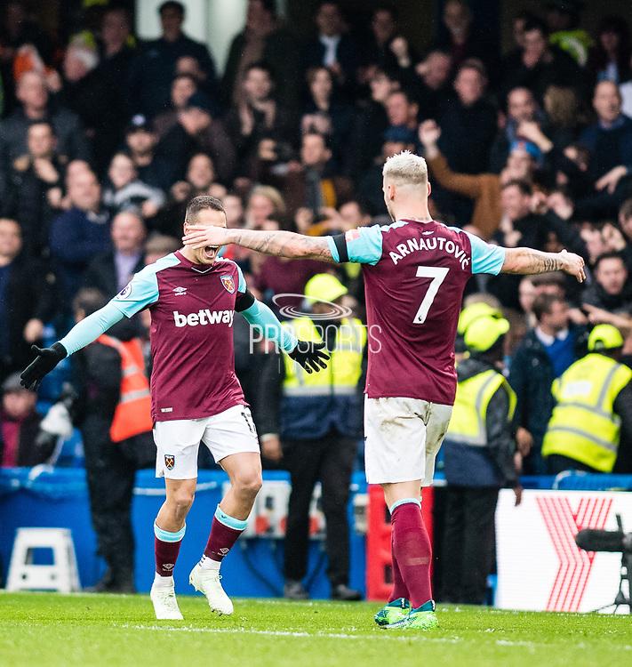 West Ham  (17) Javier Hernández, West Ham  (7) Marko Arnautović, celebrates after scoring goal during the Premier League match between Chelsea and West Ham United at Stamford Bridge, London, England on 8 April 2018. Picture by Sebastian Frej.