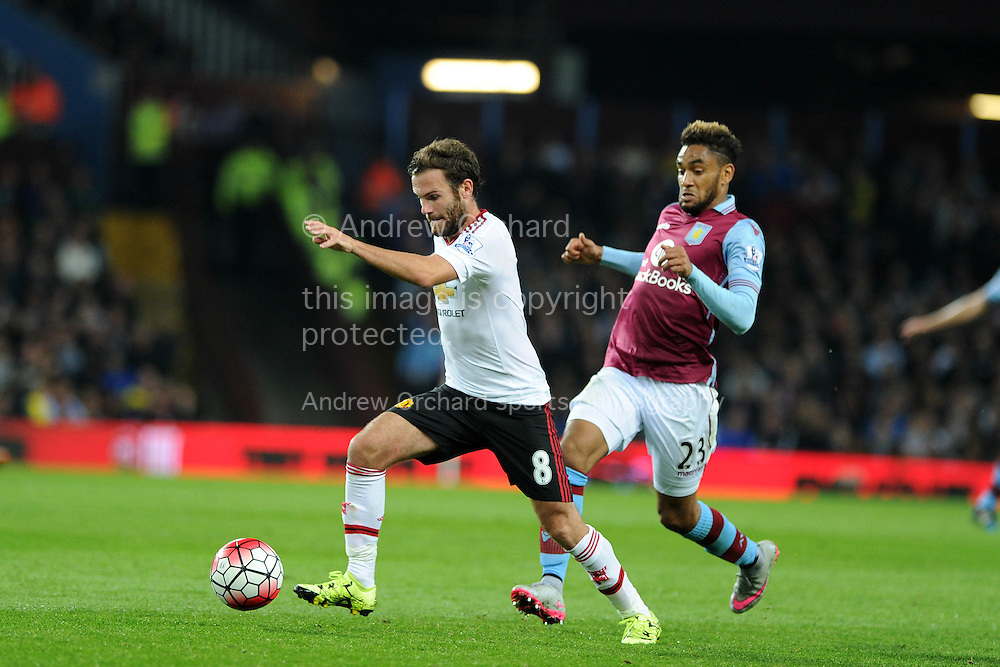 Juan Mata of Manchester Utd tries to break away from Jordan Amavi of Aston Villa (r). Barclays Premier League match, Aston Villa v Manchester Utd at Villa Park in Birmingham, Midlands on Friday 14th August  2015.<br /> pic by Andrew Orchard, Andrew Orchard sports photography.