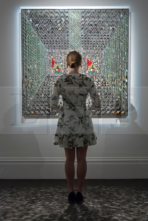 "© Licensed to London News Pictures. 20/04/2018. LONDON, UK. A staff member views ""Recollections I"", 2008, by Monir Farmanfarmaian (Est. GBP160-200k) at a preview of works in Sotheby's 20th Century Middle East, Orientalist and Islamic upcoming art sales in New Bond Street.  The works will be sold at auction in the last week of April.    Photo credit: Stephen Chung/LNP"