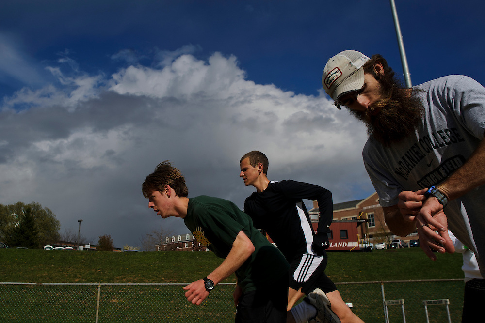 photo by Matt Roth.Wednesday, April 11, 2012..Ron Shriver, right, has track practice with McDaniel College teammates Peter Merkel, left, and Jason Stein, middle, Wednesday, April 11, 2012. .Ron Shriver is a retired marine staff sergeant. He is also the first in his family to attend college, thanks to the New G.I. Bill. His wife, a fellow retired Marine, is finishing up graduate school in Alaska. After Ron gets his undergraduate degree from McDaniel College in May, he plans to drive to Alaska with is two children Rory, 6, and Miles, 5. For the move Ron got rid of most of his family's belongings, and after his lease was up, he and his children moved back into his parent's farmhouse.