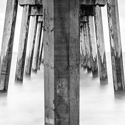 Pensacola Beach Gulf Pier pilings and Gulf of Mexico black and white panorama photo. Pensacola Beach is on Santa Rosa Island in the Southeastern United States of America. Panoramic photo ratio is 1:3. Copyright ⓒ 2018 Paul Velgos with All Rights Reserved.