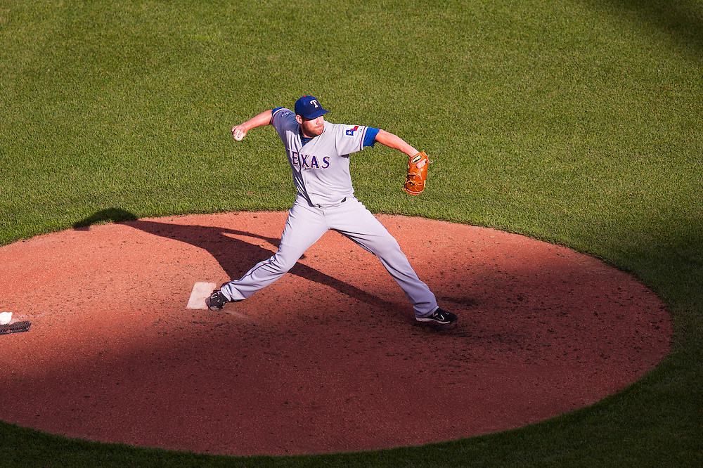 BALTIMORE, MD - MAY 10: Colby Lewis #48 of the Texas Rangers pitches during the game against the Baltimore Orioles at Oriole Park at Camden Yards during the first game of the double-header on May 10, 2012 in Baltimore, Maryland. (Photo by Rob Tringali) *** Local Caption *** Colby Lewis