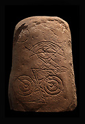 Stone from Invereen, May, Inverness-shire, carved with Pictish symbols typical of the 7th and the 8th centuries, in the National Museum of Scotland, Edinburgh, Scotland. The meaning of the symbols is unknown. The red sandstone stone was discovered in 1932 and features a crescent and v-rod symbol, a double disc and z-rod, and a circle and line which may be later in date. Picture by Manuel Cohen