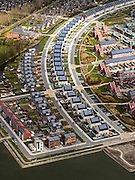 Nederland, Noord-Holland, Gemeente Heerhugowaard, 16-04-2012; verstedelijking van een polder, nieuwbouwwijk 'Stad van de zon', huizen met zonnecollectoren op het dak..Urbanisation of a polder in Heerhugowaard (NW Netherlands)  , new residential areas and urban sprawl. City of the Sun district, houses covered in solar panels..luchtfoto (toeslag), aerial photo (additional fee required);.copyright foto/photo Siebe Swart