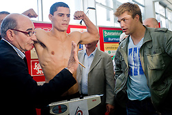 Argentina's challenger Rodolfo Ezequiel Martinez - Epi and Dirk Dzemski (R) at official weighing 1 Day before IBF World Champion title fight, on April 8, 2010, in Avto Delta, Ljubljana, Slovenia.  (Photo by Vid Ponikvar / Sportida)