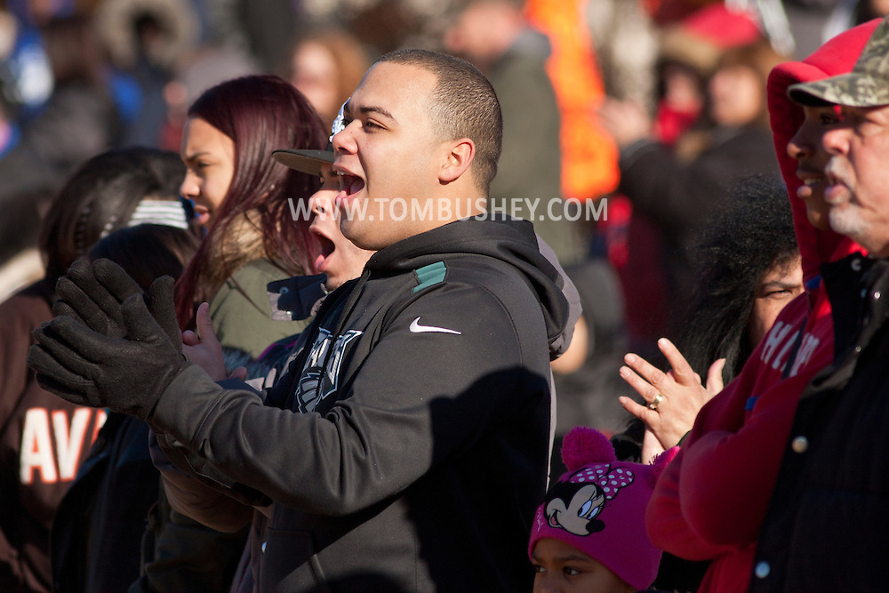 Middletown, New York - Middletown fans cheer for their team during an Orange County Youth Football League Division II semifinal playoff game at Watts Park on  Nov. 15, 2014.
