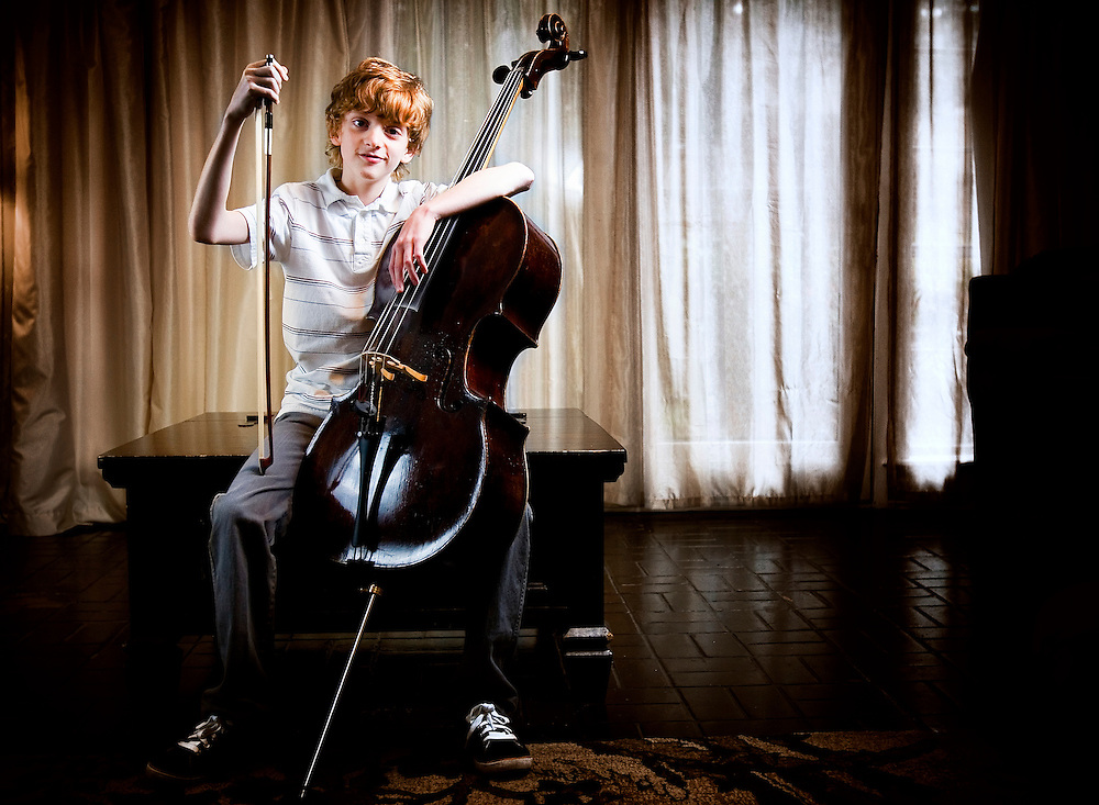 Cellist Christian Kay, age 11, was awarded a 271 year old three quarter size cello by the Carlsen Cello Foundation. The cello was made in 1740 in Austria. Kay started playing cello at the age of 8 after taking violin lessons for a year. Tuesday, October 13, 2009 Photo By Tom Turner