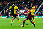 Ryan Fraser (24) of AFC Bournemouth on the attack with Troy Deeney (9) of Watford closing him down during the Premier League match between Bournemouth and Watford at the Vitality Stadium, Bournemouth, England on 12 January 2020.